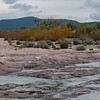 Pink Precambrian granite riverbed.  Saddleback Mountains in background.