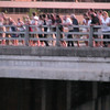 11.people were three and four deep on the bridge and the banks belowe were covered with people with huge cameras