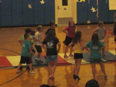 The 3rd graders danced around the room.