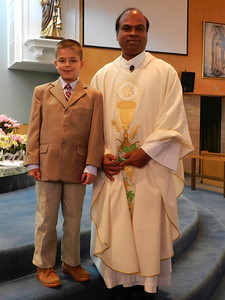 Austin with the priest