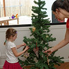 Tabitha decorating the Christmas tree