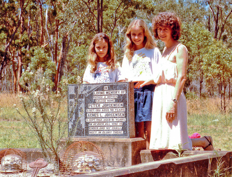 Cecilie Koch, nee Larsen, daughter of Agnes and grand-daughter of Peter Jorgensen with her daughters Christina and Angel near the grave of Peter Jorgensen and his third wife Agnes, nee Lube. This was taken at Christmas1983.