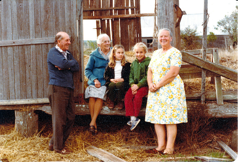 Harold and Agnes Larsen with their grandchildren Angel Kosch (now 37) , Christina Koch (now 39) and Clara Jorgensen ( wife of Max, Peter Jorgensen's youngest child ).  They are in front of the ruins of the old barn, with the ruins of Peter Jorgensen's house in the background.