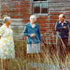 Clara Jorgensen, Agnes and Harold Larsen in front of remains of the old house