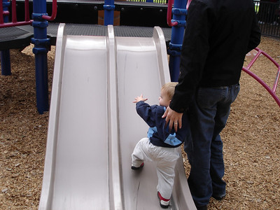I like to try to walk up the slide too.