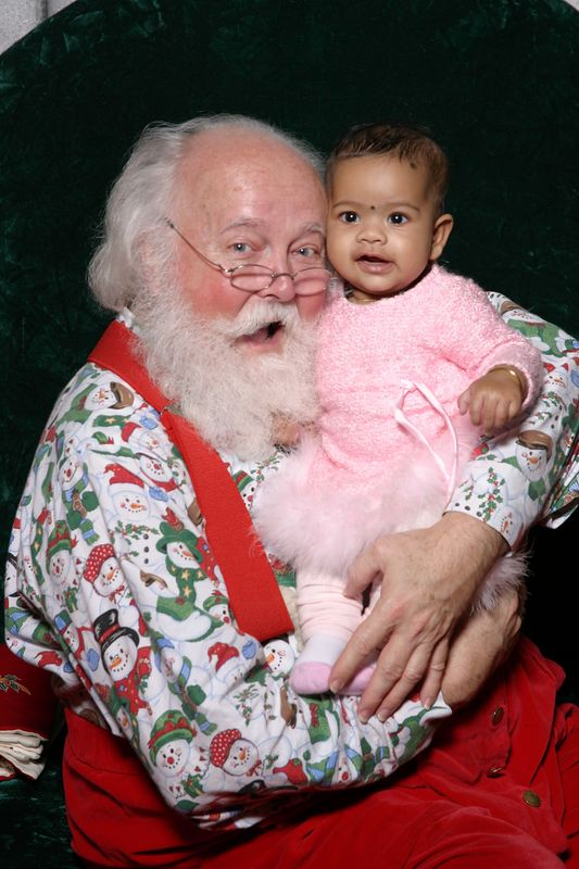 Ayushi with Santa at Alderwood mall on Dec 13th 2004.