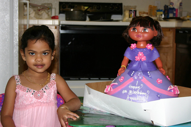 Ayushie at home with her Dora cake ...