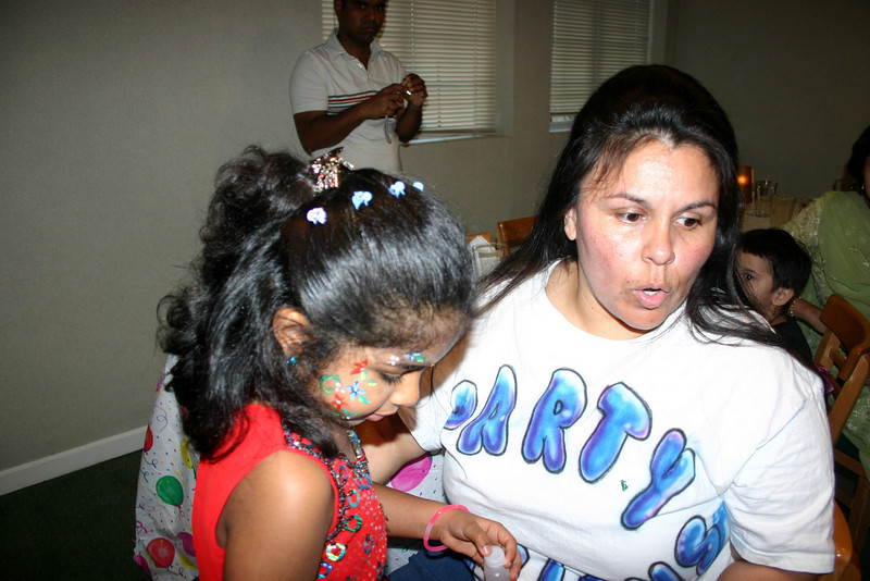 Jasmi getting her face painted ...