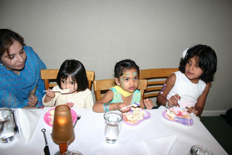 Jasreen, Ayushie and Aishuie enjoying the cake.
