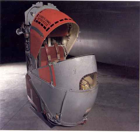 """The original B-58, upon delivery to USAF, had """"open-seat"""" ejection seats.  This pictures the later """"encapsulated"""" ejection seat.  The crewmember wore no parachute or mae west.  The capsule closed, locked, and ejected.  It protected the crewmember ejecting at supersonic speeds.  Upon hitting water, it floated.  In normal """"flying"""" mode, each of the """"clamshell"""" sections were retracted to the red section you see there.  The capsule was loaded with emergency clothing, radio, rations, water and a 22/410 combination rifle and shotgun."""
