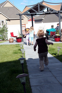 The girls loved running up and down Uncle Mikes sidewalk
