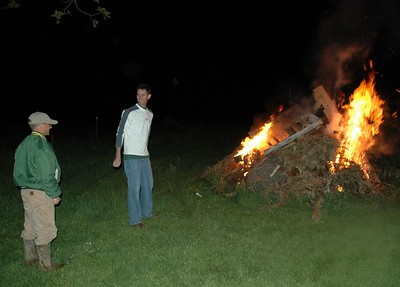 Noel and Dean starting the fire