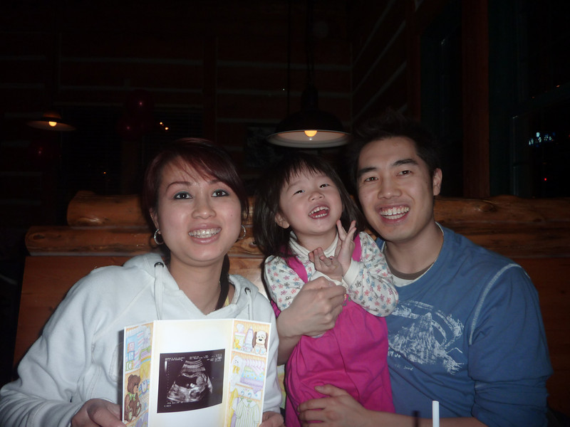 At time of this photo, baby Hayden was still in Mommy's tummy.  Linh was holding the ultrasound image of the baby.