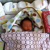 Little Hayden is sleeping.  He has cool hair!!!