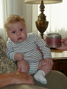 Joey on Mary Ann's lap listening to the music box from Aunt Marie
