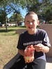 Henry gets the watermelon out of a fruit salad in the park at San Vicente