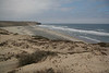 Sand Dunes north of Bahia San Quintin on Pacific coast. People were gathering smooth river cobbles and bagging them.