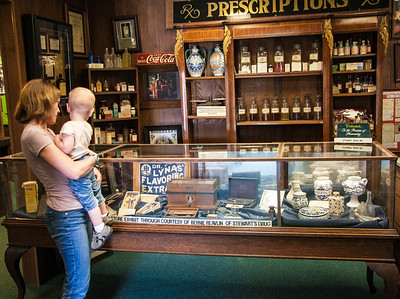 The old restored pharmacy at the oil museum, with Julie and Carson.