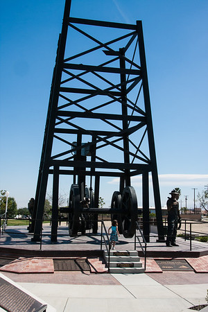 Monument in downtown Taft to oil workers. Bronze statue on the right is one of the largest of its type in the country.