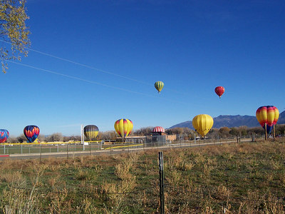 More balloons begin to land across the road.