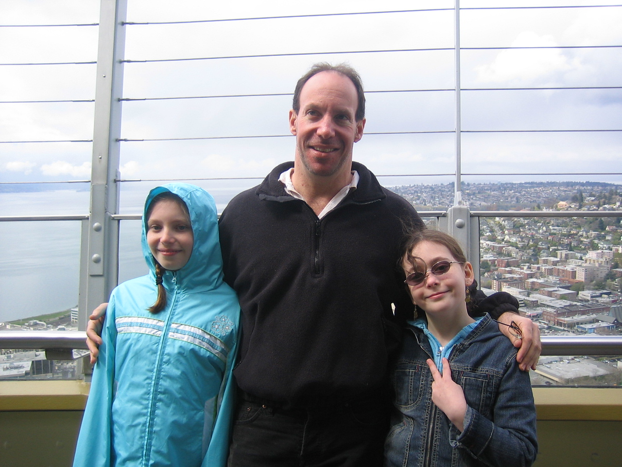 Emily, Barry and May (flashing some sort of gang sign) on top of the Space Needle.