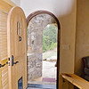 hobbit-door to outside from kitchen/living space.  Bench inside door to remove shoes.