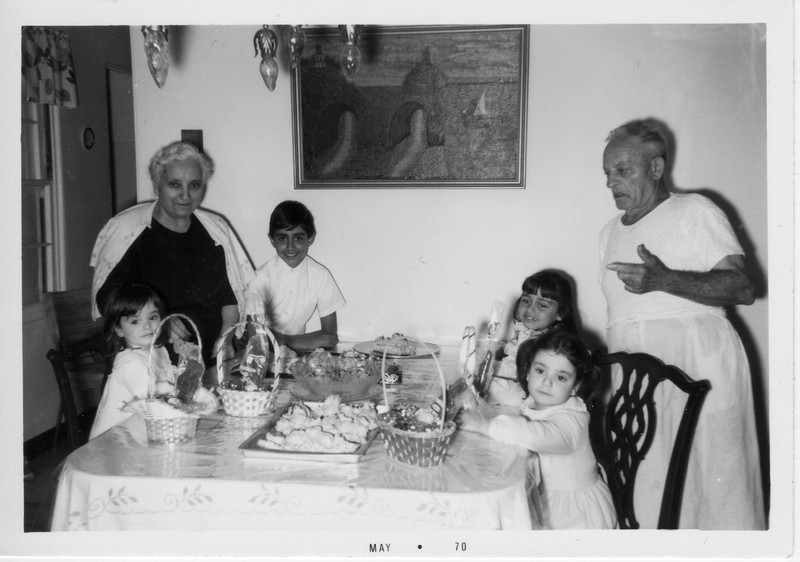 Grandparents Margherita and Dominico Balistreri entertain their grandchildren: Margaret Giammarresi, Phil Battaglia, Dorothy Battaglia, and Angela Giammarresi.