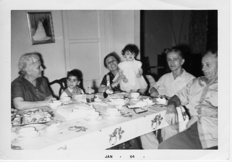 Dorotea Battaglia holds the birthday girl, her granddaughter and namesake, Dorothy Battaglia. Celebrating as well are Dorothy's brother, Phil, and other grandparents Margherita Balistreri (left), Filippo Battaglia (second from right), and Dominico Balistreri.