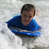 Sam catching a wave