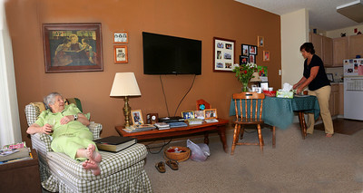 a view of the living room, new flat screen tv programed to CNN Her little girl photo and family pictures.