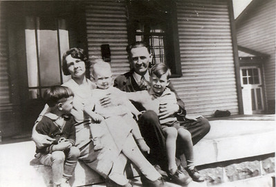 Maud and George with this children Ray, Herman, and Edwin. Front: Ray, Herman, Edwin Back: Maud & George Curtis