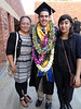 Outside, Beau poses with Jaelynn and Nicole - Jaelynn made all the awesome leis for Beau.