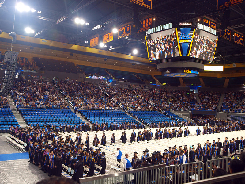 The is the 7pm (second half) ceremony. Half of the 4100 graduates start filing in.
