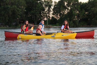 Jen Snyder in the yellow kayak. Claire Jennings, Amanda Snyder and Natalie Jennings in the canoe.