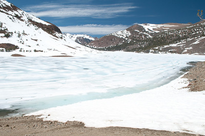 Oops.  Our trout fishing lake at 10.000' is still frozen over at the end of June