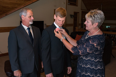 Cheri attaching Mike's boutonniere
