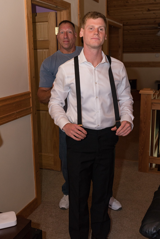 Steve hitching up the the groom's braces