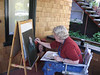 Sally, Nancy's cousin, painting portraits