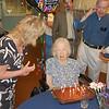 Carol, Nancy, and Bob surprise Beth with cake.