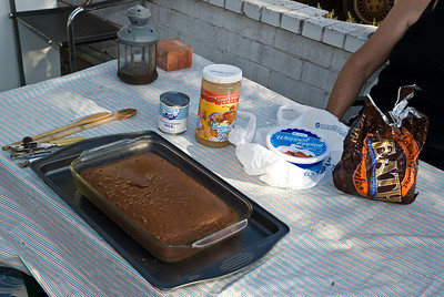To make a better than sex cake, this is what you start with. A prepared German Chocolate cake (must), condensed milk, caramel sauce, Cool Whip and crushed Heath Bars. The only tools needed are a can opener and wooden spoons.