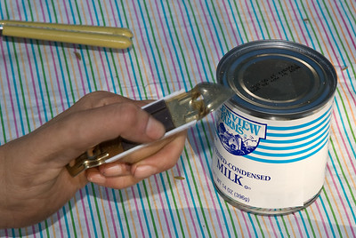 You may think that it's best to use this bottle opener for the condensed milk. Don't. Use a can opener and remove the whole lid. Open up all that sweet, creamy goodness!