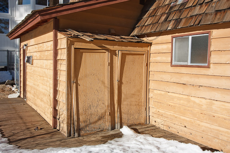 Storage shed. The back bathroom water drains are inside the left door