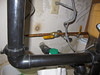 Under the kitchen sink:<br /> The yellow handles are the hot and cold water shutoff valves to the back bathroom<br /> <br /> The    left handle is in the ON position, parallel to the water pipe<br /> The right handle is in the OFF position, perpendicular to the water pipe