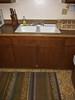 Kitchen Sink.<br /> <br /> Water Shutoff to back bathroom is under the sink