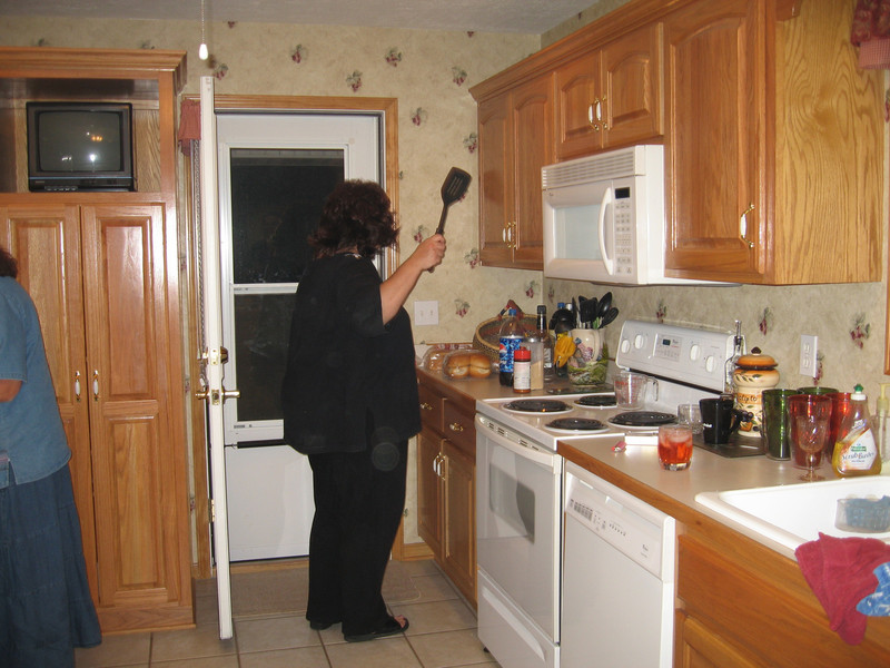 Lori cooking & swating a fly at the same time!  MMMMMMMMM tasty!<br /> <br /> But no, Lori is really a Very good cook.