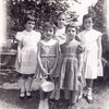 Backyard in Rego Park, 1960:<br /> Left: Sari, Helen Monteleone (neighbor), Evie, Karen