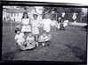Garfinkels Bungalow Colony:<br /> Front: Miriam Gershbaum, David Birnbaum, Manny Miller<br /> Back Row: Hauser girl (?), Judah Gershbaum, Sammy (?)<br /> Background: Toddler (is it Eli? Evie? Sari had dark hair, and I think Evie would've been younger) and Rhoda
