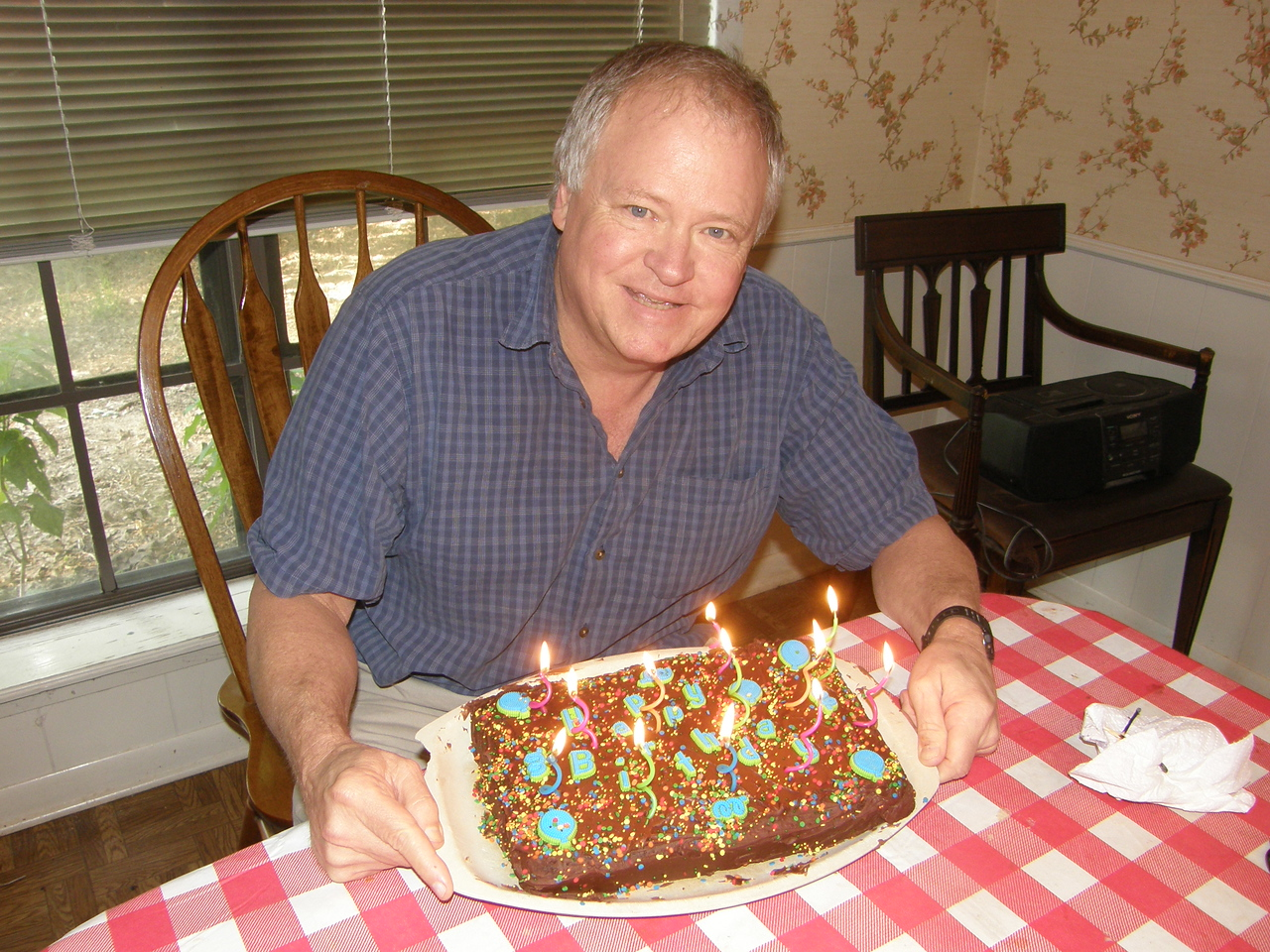 Happy Dad with birthday cake.   Ronnie Humphries  age 61 and still going strong! Er, well fairly strong.