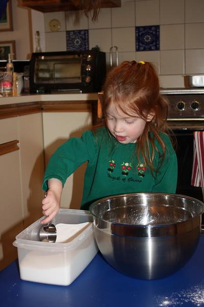 Keira helping to make her birthday cake.