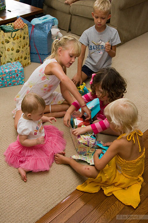 Lizzie opens her presents with a little help